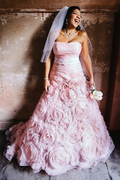 Go for full-on romance in a pink gown covered in rosettes.