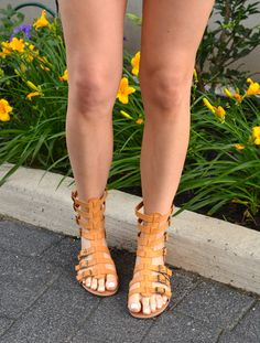 Tan gladiator sandals and white nails
