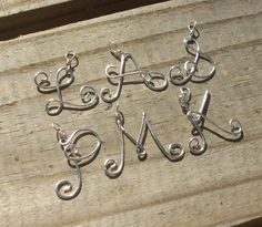Silver wire Name Initial Necklace. $9.95, via Etsy.