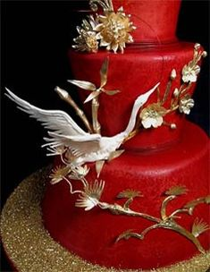 Unusual three tier red wedding asian cake decorated with gold cherry blossoms, bamboo, flowers and gold dust. Bride and groom birds wedding cake topper. From www.justcake.com         ........   #wedding #cake #birthday