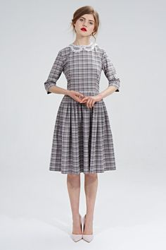 Mrs Pomeranz Aretha dress is produced of beautiful pink/grey tartan costume wool.  The Peter Pan lace collar was handmade in the town of Sovetsk (the