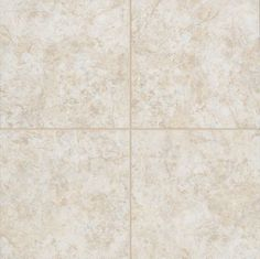 BATHROOM- Perrero - Wheystone Cream: Surface Finishing is used as the flooring in the bathroom.