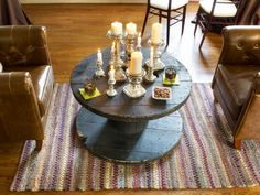 To create the look and feel of a lounge, center club chairs around any object with the proper scale, shape and height for use as a temporary cocktail table. Here, the center of the living room was used as a men's lounge with a pair of tufted chairs flanking a repurposed rope spool. From DIYnetwork.com