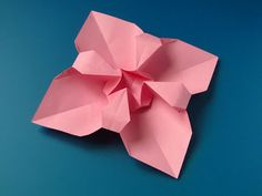 Fiore quadrato  - Square Flower.  Origami, from a sheet of copy paper, 21 x 21 cm.  Designed and folded by Francesco Guarnieri, April 2013. Instructions, CP: http://guarnieri-origami.blogspot.it/2013/04/fiore-quadrato-square-flower.html