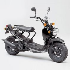Got to get myself one of these badboys.  I love the utilitarian looks of this motor scooter – the Honda Zoomer.  + Zoomerzine
