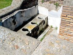 ANTIQUE LATRINE    Roman engineers understood some of the important aspects of basic sanitation, including efforts to keep human excrement away from sources of drinking water. This latrine, in Ostia Antica, fed directly into a sewer.