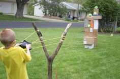 DIY      Boxes + Angry Bird dog toys + homemade sling shot (Y stick and a water balloon launcher secured to a board and platform that the person stands on)= tons of exercise, laughter and fun!!