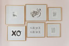 Nursery Gallery Wall - love these black and white prints in gold frames!