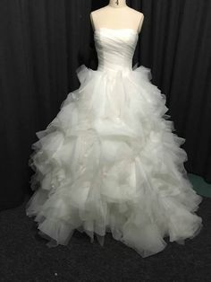 White organza ball gown wedding dresses like this can be made in a color and used for other formal special occasions.  See other #ballgowns in our collection that you can customize when you visit our main website.
