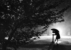 "Richard Stacks: With this April 1955 photo of a woman in a Baltimore park titled ""A Drink in the Rain,"" Stacks won Best in the Pictorial Cla..."