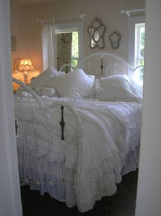 Awesome!! ♥ (Shabby Prim Delights) I'm not sure what I love more..the iron bed or that gorgeous white ruffled bedding.
