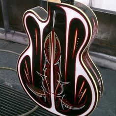 Pinstriped guitar... very nice.                                                                                                                                                      More