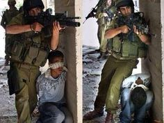 #Israel uses #Palestinian boy as a #HumanShield.  Who's the war criminal here?