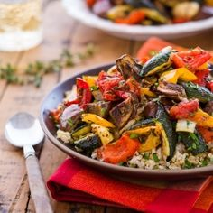 Colorful roasted mix of fresh sweet peppers, eggplant, onion, zucchini and tomatoes with herbs. Side dish or vegan main dish over rice