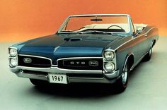 GTO...rode in one of these one time with Bill Gerhart. It's amazing the stuff you remember. I remember the Hurst stick shift, the way the car sounded, and the way it jumped when you shifted. Coolest thing ever.