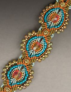 Joan Babcock class. The colors and the use of the small magatamas or drop beads on the outside cord gives this bracelet the perfect finish.