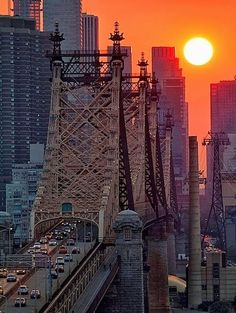 sunset view of the traffic on Brooklyn Bridge