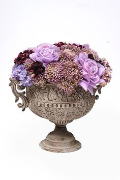 A beautiful purple arrangement created by Neil Whittaker for Country Baskets