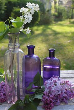 purple glass with lilacs.  photo from laura @ 52 flea.