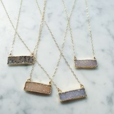 """The druzy stone is one of our customer's favorite at Paisley + Sparrow! This gorgeous 30mm stone hangs 8.5"""" on a soldered gold chain for a short necklace that will add a pop of sparkle. Each item in P"""