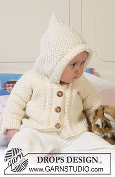 """DROPS jacket in seed st with body piece and sleeves knitted in one and with hood, textured pattern and cables in """"Merino Extra Fine"""". ~ DROP..."""