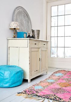 Decorating with Boucherouite rugs. Awesome colors!