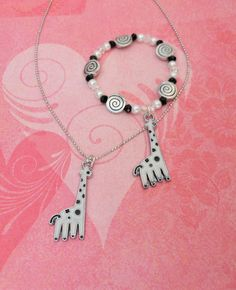 Children's Giraffe Necklace and Bracelet Set features a silver plated 14 inch necklace and a matching crystal and pearl beaded bracelet.  The Mermaid Apothecary via Etsy.com