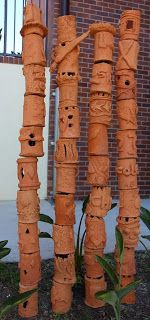 Ceramic totems. This would make a great fundraising project!