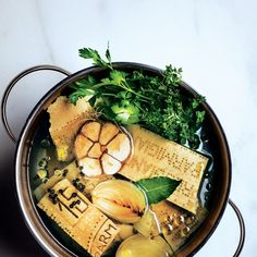 Parmesan rind broth: Use this rich and versatile broth in vegetable soups, instant-supper pastas, such as Capellini en Brodo, and beans in need of a boost. Parmesan Rind, Cooking Tips, Cooking Recipes, Biryani, Soup And Salad, Soups And Stews, Bon Appetit, Soup Recipes, Gastronomia