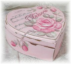.Just a quaint little rose heart box I would find a use for it.