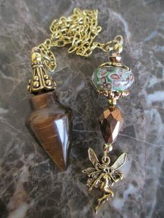 Tiger Eye Stone Fairy with Murano Glass Bead Crystal Scrying Dowsing Pendulum on Etsy, $25.77 AUD