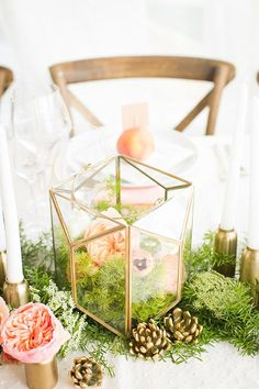 Moss with minimal flowers, glass and gold tones. Centerpiece