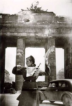 Russian soldier directs traffic at the Brandenburg Gate. Berlin, 1945.