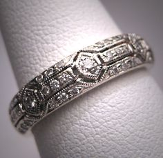 A Stunning Vintage Diamond Wedding Band Ring, Art Deco Style Set in 14K White Gold. This beautiful estate ring holds thirty nine (39) genuine white sparkling diamonds set in a triple row Art Deco design. The setting has fine detailing and bits of openwork and is composed of 14K white gold. The band is about 5mm wide.    #AmericanGemSociety  @pinterest.com/amergemsociety/