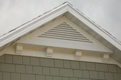 home exterior triangle mission-style gable attic vent with shingle siding. love the corbel detail.