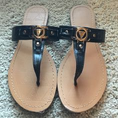 Lightly worn guess sandals !! Black and gold. Guess sandals size 8 great condition, barely worn Guess Shoes Sandals
