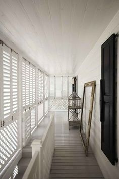 India Hicks - grey floor boards with white shutters Home addition master porch and stairs Porch Lattice, White Shutters, British Colonial Style, Ikea, Queenslander, Grey Flooring, Tropical Houses, Airstream, Beautiful Homes