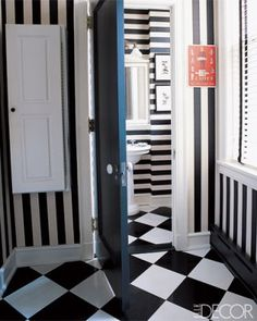 Vertical stripes in the laundry room, horizontal stripes in the bathroom via Elle Decor
