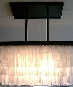 Amazing angular wax paper chandelier (I love that it looks like the long rectangular West Elm one I adore).