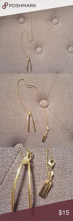 Marc Jacobs Wishbone Necklace Cute gold necklace by Marc Jacobs in shape of wishbone.  Long chain with Marc Jacobs logo tag at end.  **pls note that this is not real gold, more than likely a plated finish of sort. Not 100% sure on material!** Marc Jacobs Jewelry Necklaces