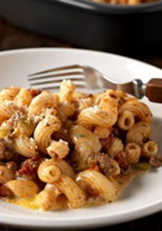 Cheesy & Beefy Tomato Corkscrew Pasta Bake -- With just 10 minutes of prep, it's hard to top this easy, cheesy pasta bake recipe!