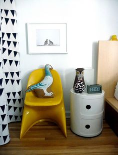 pigeon cushion, yellow chair and night stand