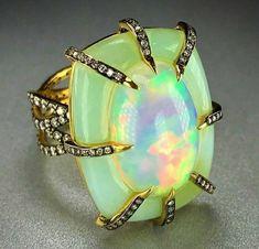 Woah!! Thats a unique opal ring.