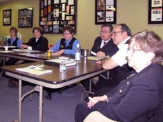Our tour directors listen intently during a meeting.