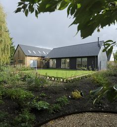 A contemporary family dwelling in Cumnor, Oxfordshire. The new dwelling is very much the result of a collaboration between us and our clients. Modern Bungalow Exterior, Cottage Exterior, Metal Building Homes, Building A House, House Extension Design, House Design, Restoration House, Modern Barn House, Bungalow Renovation