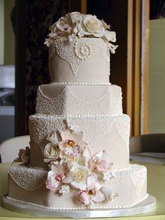 gorgeous octagon and round tiered cake with lace and floral accents by Cakes to Remember