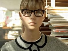 Must be the glasses. Or the pearls. Or that sweater.