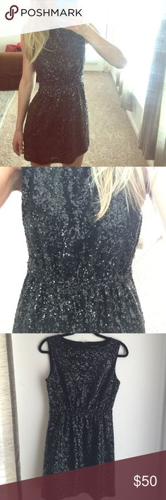 Madewell (Broadway & Broome) black sequin dress 2 Sparkly, fun black sequin dress originally purchase from Madewell. Brand is Broadway & Broome. Size 2, in excellent condition (all sequins intact!). Beautiful dress for a fun celebratory night out. 100% polyester 100% polyester lining. Fits true to size. Madewell Dresses Mini