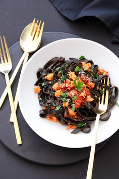 Spicy Squid Ink Fettuccine with Shrimp and Chorizo made with homemade squid ink pasta tossed with a spicy tomato sauce made with Spanish-style chorizo and fresh shrimp. Chorizo Recipes, Spicy Recipes, Cooking Recipes, Cooking Fresh Pasta, Black Pasta, Squid Ink Pasta, Fettuccine Recipes, Spicy Tomato Sauce, Spicy Shrimp