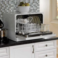 Countertop Dishwasher. I NEED THIS. A few years without a dishwasher has killed me. Haha
